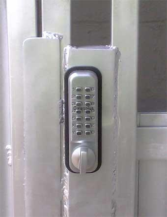 A Digital lock mounted in a security Gate