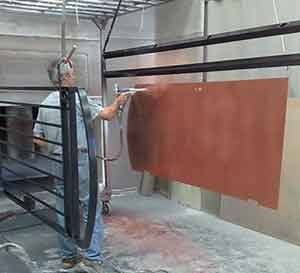 Power coating a backing sheet of a gate