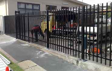 Sliding gate with steel fencing