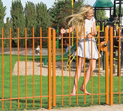 girl on a gate swinging
