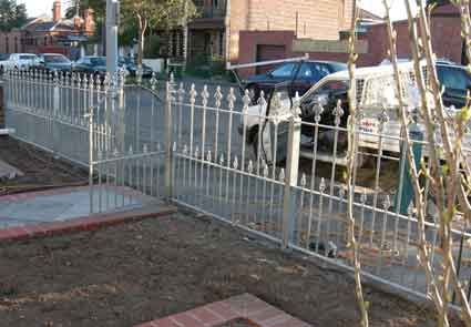 finished work on a wrought iron fence