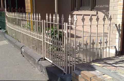 wrought iron fence under repair