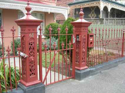 Wrought iron qate with lion post